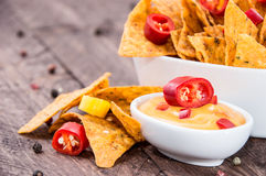 Portion of Nachos with Cheese Sauce Royalty Free Stock Photos
