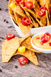 Portion of Nachos with Cheese Sauce Stock Photo