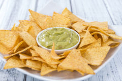 Portion of Nachos (with Guacamole) Stock Photos
