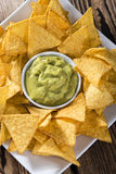 Portion of Nachos (with Guacamole) Royalty Free Stock Photos