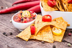 Portion of Nachos with Salsa Sauce Stock Photo