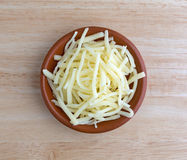 Portion of natural white mild cheddar cheese in bowl Royalty Free Stock Image