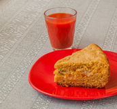 Portion of oat flour cake and glass of tomato juice Stock Images