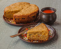 Portion of oat flour cake and mug  of tomato juice Stock Photo