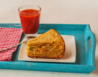 Portion of oat flour cake and mug  of tomato juice on a tray Royalty Free Stock Photography