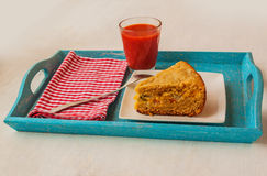 Portion of oat flour cake and mug  of tomato juice on a tray Stock Photos
