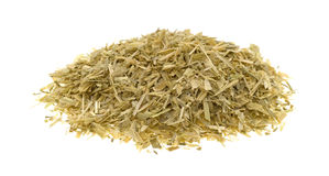 Portion of oatstraw herb on a white background. A small pile of oatstraw herb isolated on a white background royalty free stock photo