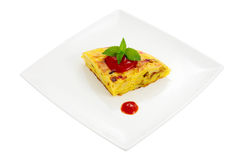 Portion of omelet. Dish with portion of spanish omelet made with potato egg peppers and onion cut and isolated Stock Photo