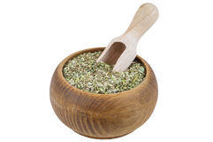 Portion of oregano spice in wooden bowl Royalty Free Stock Photo