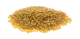 Portion of organic golden flaxseed on a white background Royalty Free Stock Photos