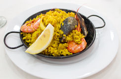 Portion of paella served in metal plate Royalty Free Stock Images