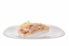 Portion of pancake with cheese and ham on a plate Royalty Free Stock Photography