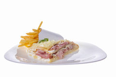 Portion of pancake with french fries. Portion of pancake with ham and cheese with french fries aside royalty free stock images