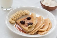 Portion pancakes with srawberry jam and bananas Royalty Free Stock Image