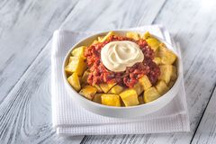 Portion of patatas bravas with sauces. Close-up stock photography