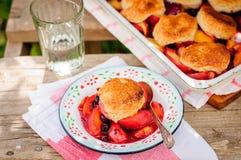 A Portion of Peach and Black Raspberry Cobbler Stock Photos
