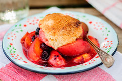 A Portion of Peach and Black Raspberry Cobbler. Close up royalty free stock photos