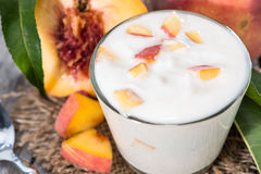 Portion of Peach Yogurt Stock Photos