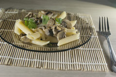 Portion of penne rigato with mushrooms Stock Photo