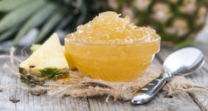 Portion of Pineapple Jam. Portion of fresh made Pineapple Jam with some fresh fruits Royalty Free Stock Image