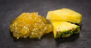 Some Pineapple Jam on a dark slate slab. Portion of Pineapple Jam on a rustic slate slab, selective focus, close-up shot Stock Images