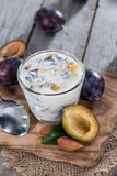 Portion of Plum Yoghurt Royalty Free Stock Photos