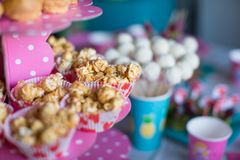 Portion popcorn on kid's party on sweet dessert Royalty Free Stock Photos