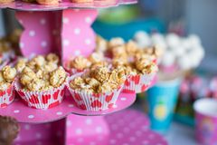 Portion popcorn on kid's party on sweet dessert royalty free stock image