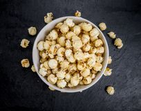 Portion of Popcorn on a slate slab royalty free stock photos