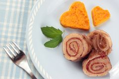 Carrot hearts with pork roulade. A portion of pork roulade with mashed carrot Royalty Free Stock Photos