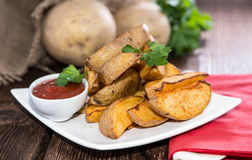 Portion of Potato Wedges Stock Photo