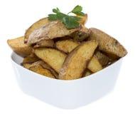 Portion of Potato Wedges on white Stock Photos