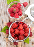 Portion of preserved Raspberries. Preserved Raspberries in a glass with some fresh fruits Stock Photography