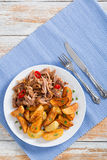 Portion of pulled slow-cooked delicious meat stock images