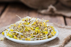 Portion of Radish Sprouts. Some fresh Radish Sprouts on rustic wooden background Royalty Free Stock Images