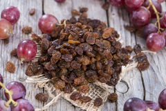 Portion of Raisins. With some fresh fruits Royalty Free Stock Photos