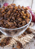 Portion of Raisins. With some fresh fruits Royalty Free Stock Photography