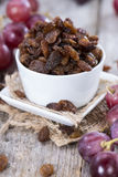 Portion of Raisins. With some fresh fruits Stock Images