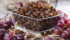 Portion of Raisins. With some fresh fruits Royalty Free Stock Photo