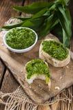 Portion of Ramson Pesto. Portion of fresh homemade Ramson Pesto on rustic background Royalty Free Stock Image
