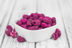 Portion of Raspberries dried, selective focus Stock Photos