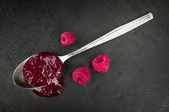 Portion of Raspberry Jam on a slate slab. Some Raspberry Jam on a slate slab as detailed close-up shot; selective focus Royalty Free Stock Photo