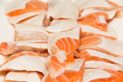 Portion Raw salmon slice  on ice. A portion Raw salmon slice  on ice Royalty Free Stock Image