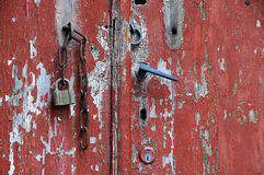 Portion of Red Grungy Door Stock Image