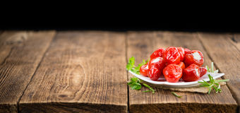 Portion of Red Pepper & x28;stuffed with cheese& x29; on wooden background. Fresh made Red Pepper & x28;stuffed with cheese& x29; on an old and rustic wooden Royalty Free Stock Photos