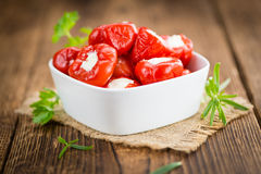 Portion of Red Pepper stuffed with cheese on wooden background. Fresh made Red Pepper stuffed with cheese on an old and rustic wooden table selective focus Royalty Free Stock Photography
