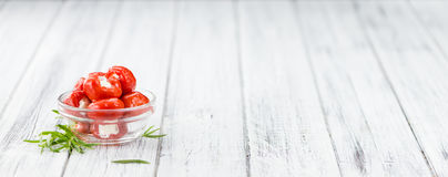 Portion of Red Pepper stuffed with cheese on wooden background. Fresh made Red Pepper stuffed with cheese on an old and rustic wooden table selective focus Stock Photo