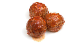 Portion roasted meatballs under meat sauce Royalty Free Stock Image