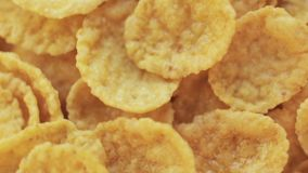Portion of rotating cornflakes. Cornflakes close-up rotating background. Macro shot stock video footage