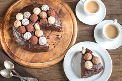 Portion of Sacher torte with two cups of coffee Royalty Free Stock Photo